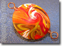 Polymer Clay Orange Swirly Lentil Bead